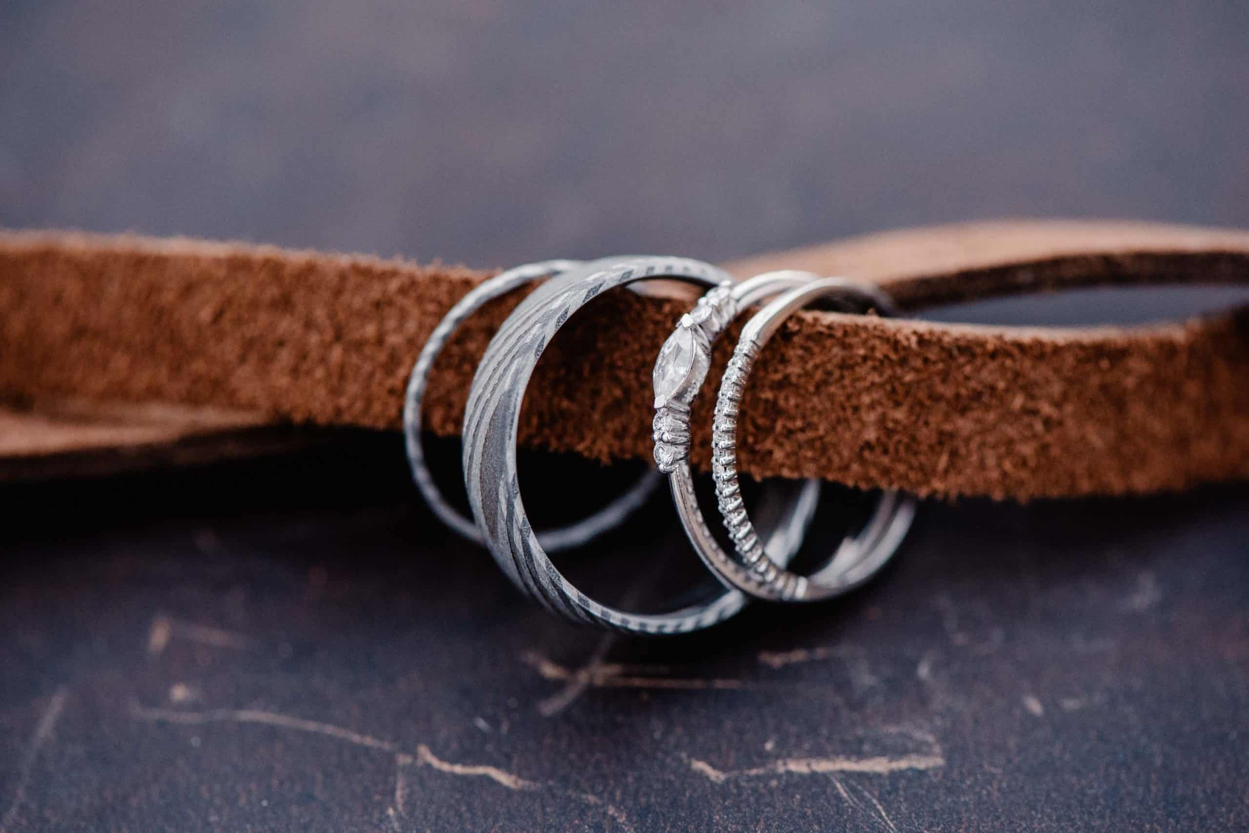 leather straps tied together with rings hanging on the straps
