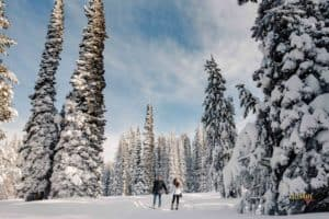 couple snowshoeing for their engagement photos