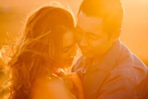 couple cuddling at an Albuquerque elopement and desert elopement wedding