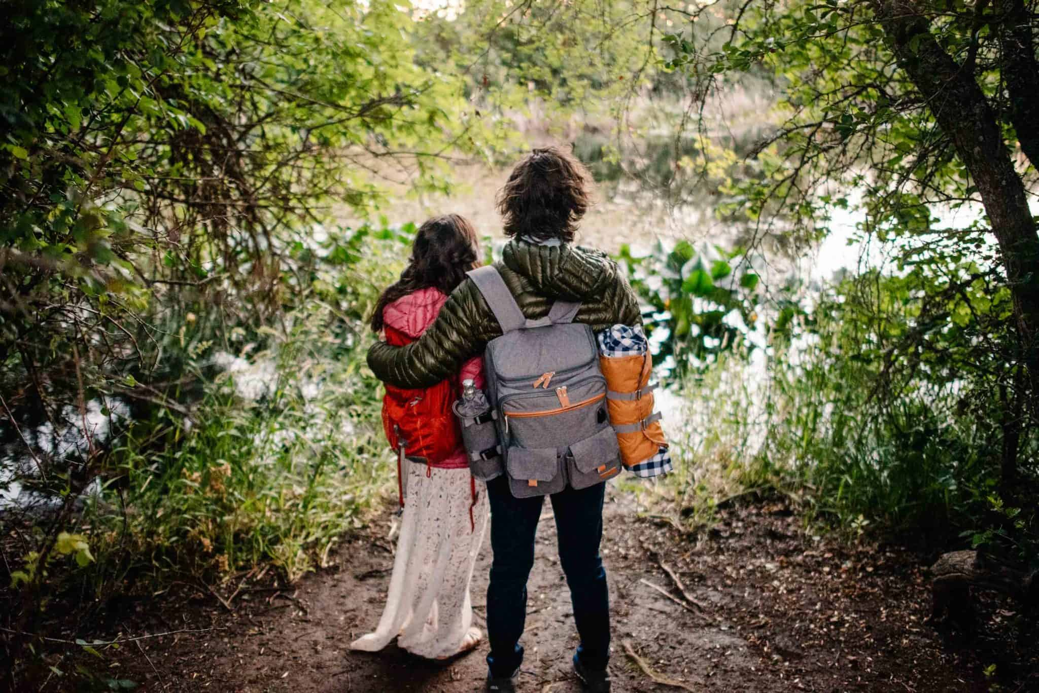 couple wearing picnic backpack