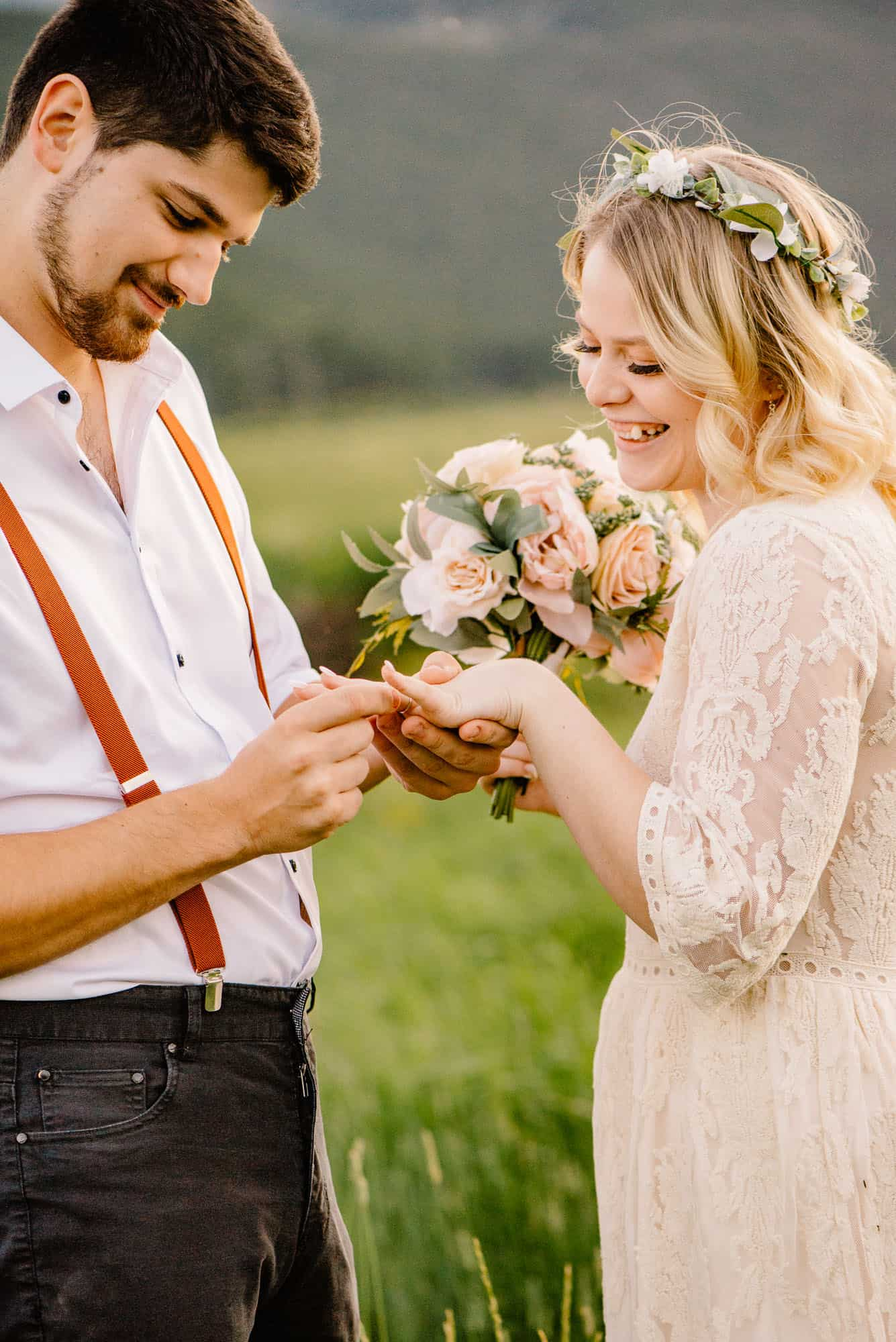 groom putting his brides ring on because he added it to his packing list for elopement