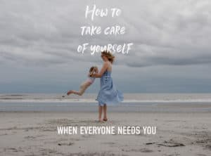 "self care as a mom ""how to take care of yourself when everyone needs you a conversation and meditation"" photo of emmy and her daughter on a beach"