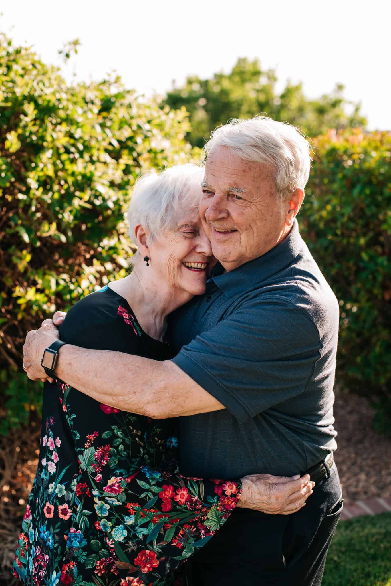 an elderly couple laughing after having joked together having followed this romantic things to do for wife idea list