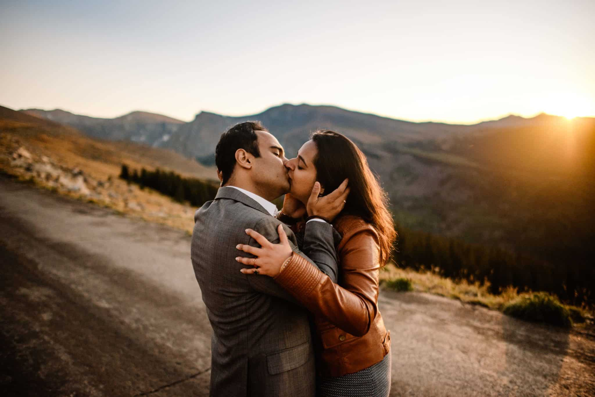 couple kissing as the sunsets behind them having followed this romantic things to do for wife idea list
