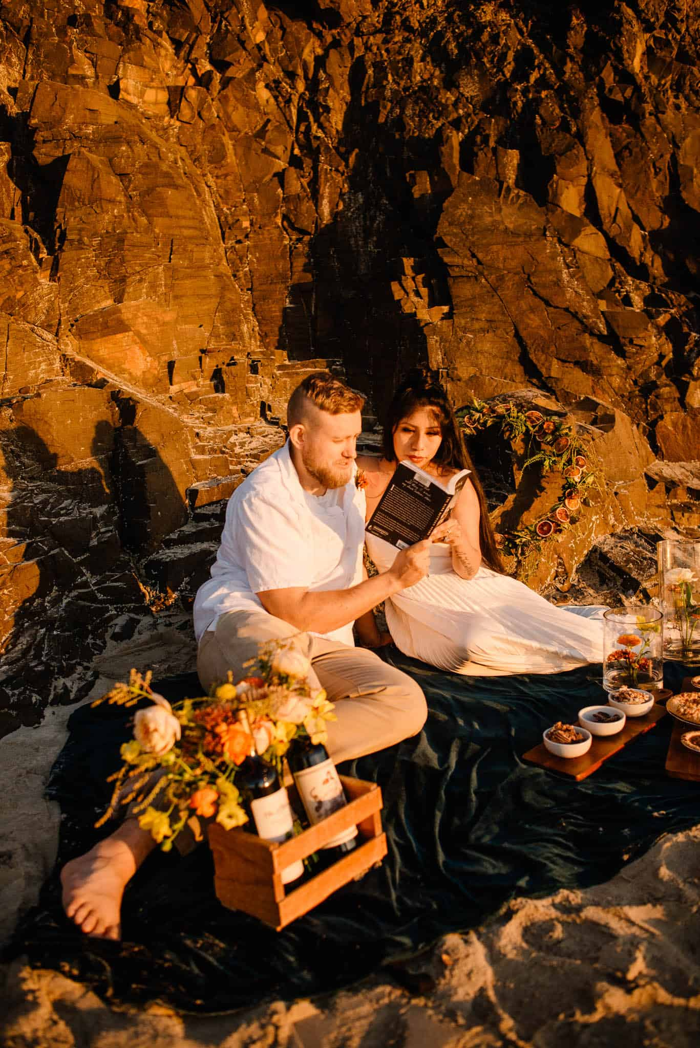couple on the oregon coast reading a book together having a picnic on the beach having followed this romantic things to do for wife idea list
