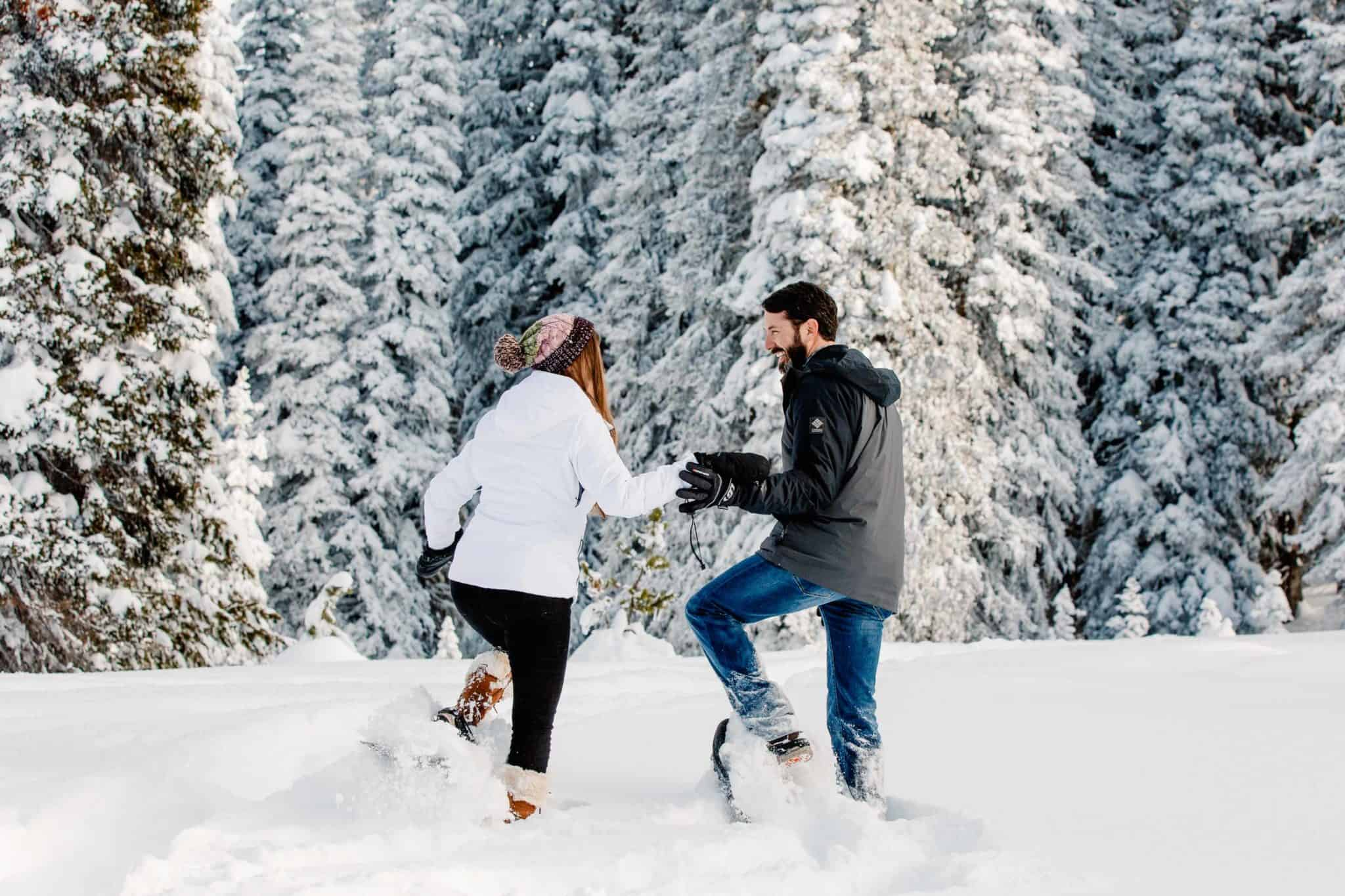 couple laughing and playing in the snow