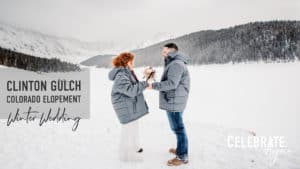 """Clinton Gulch Dam Reservoir Winter Mountain Wedding Colorado"" photo of a couple exchanging vows in winter coats on a wintery day in the mountains of Colorado"