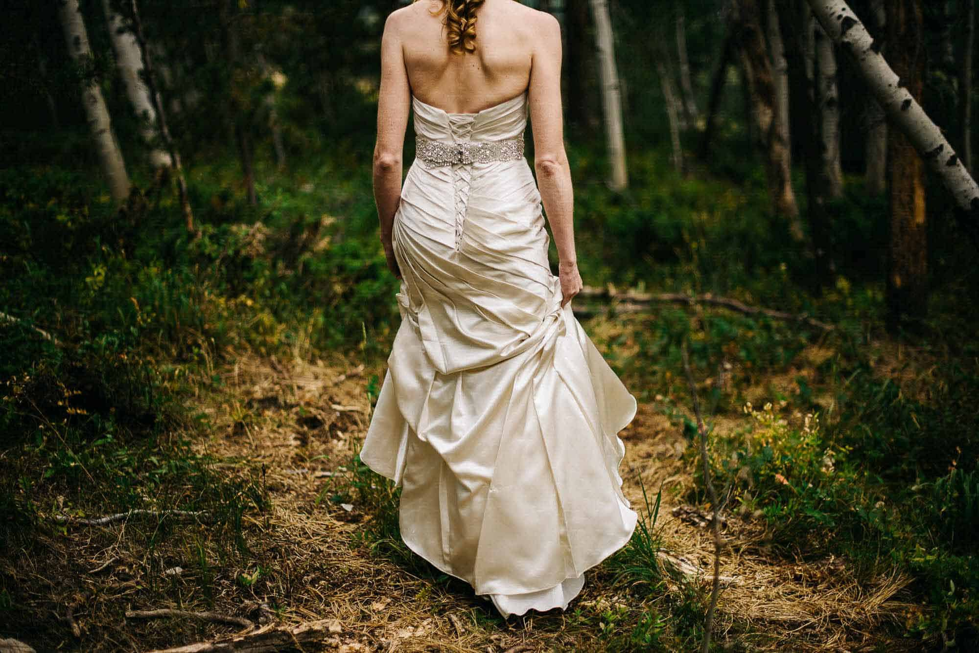 bride walking away into forest
