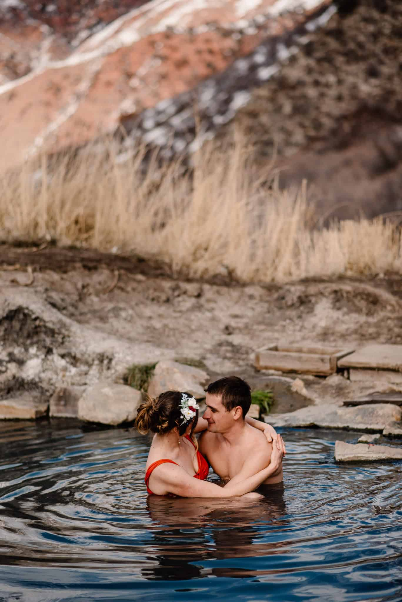 couple in hot springs after their santa fe new mexico elopement