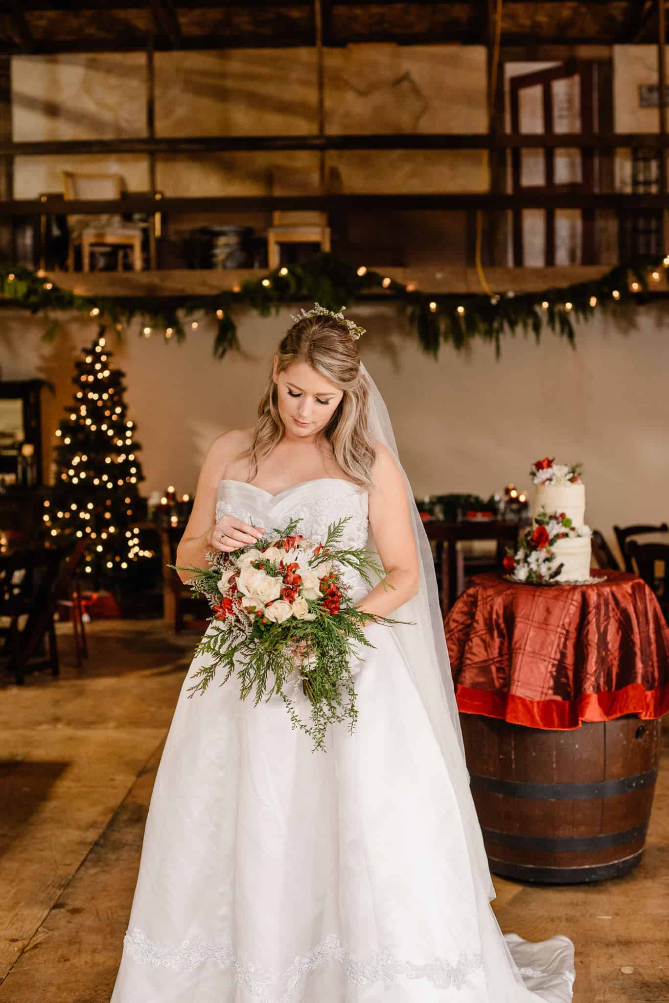 bride holding flowers in an old barn