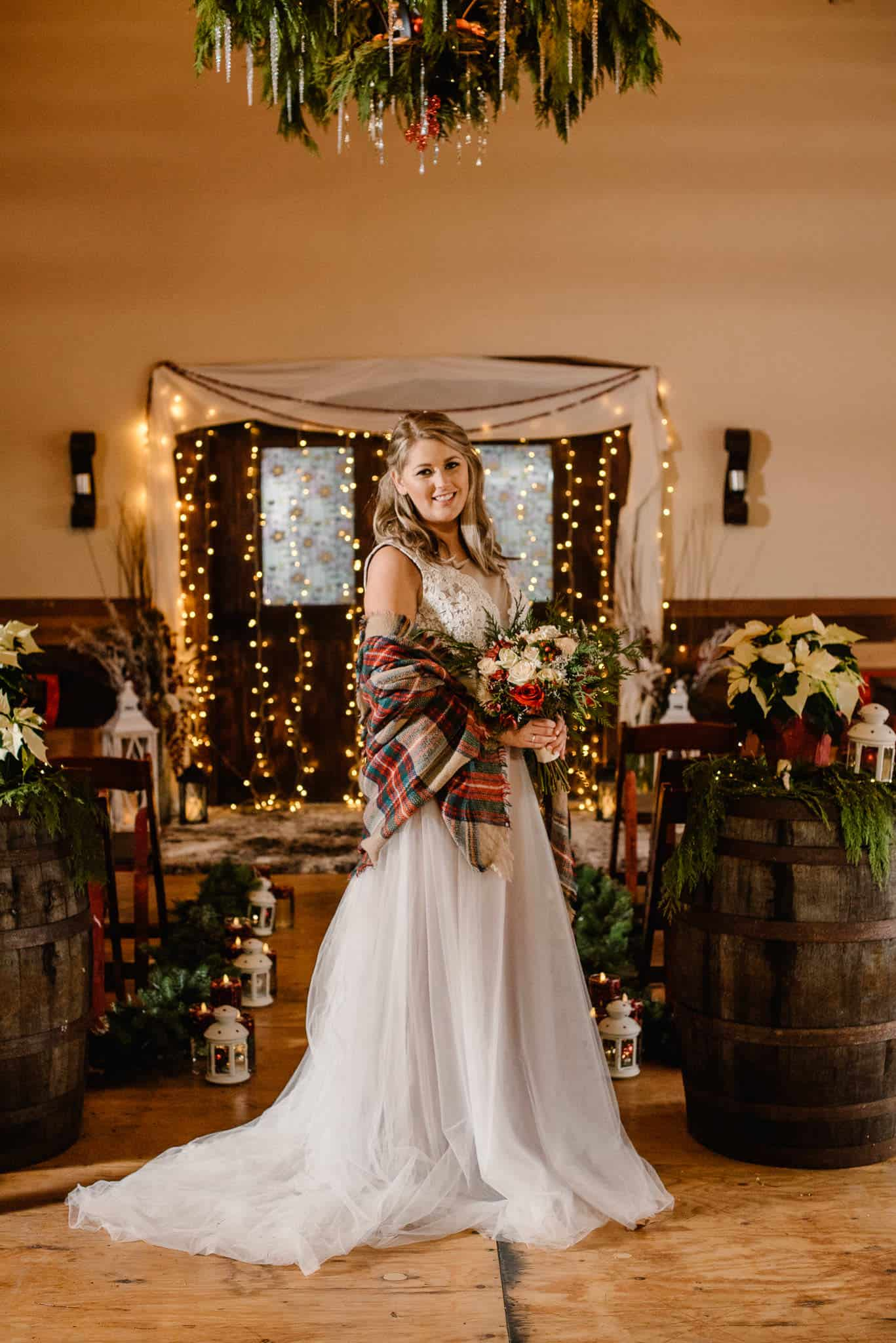 Heavenly bridal dress bride in dress in christmas decor holding flowers smiling at camera