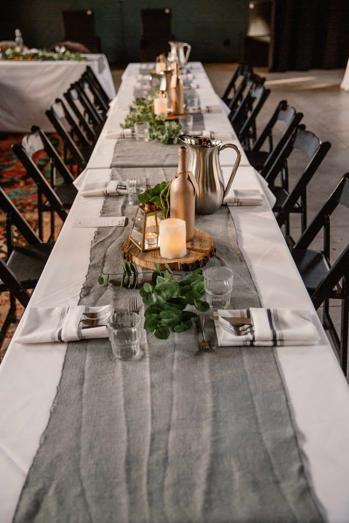 view of a small dinner reception table decorated