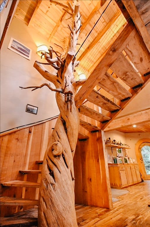 view of a tree as a part of the stair case in a wooden home