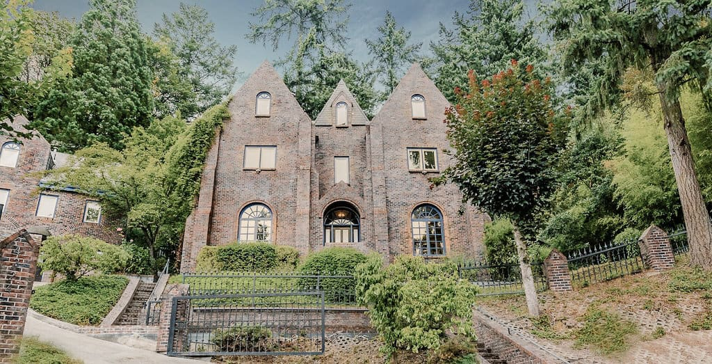 view of the front of a castle like estate in Portland perfect for an airbnb wedding venue or couples tay