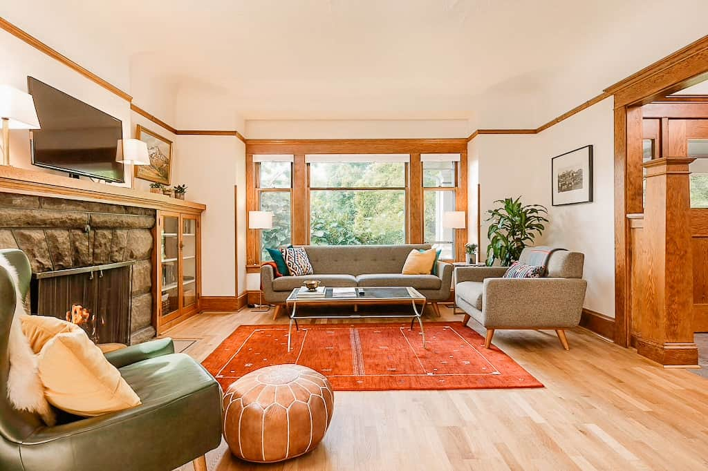 view of a cozy inside of a home with a living room and orange carpet