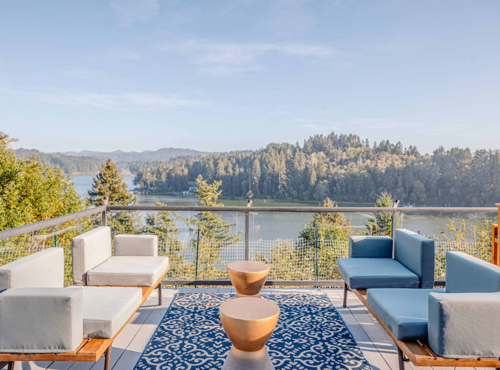 luxury modern chairs on a deck overlooking a lake