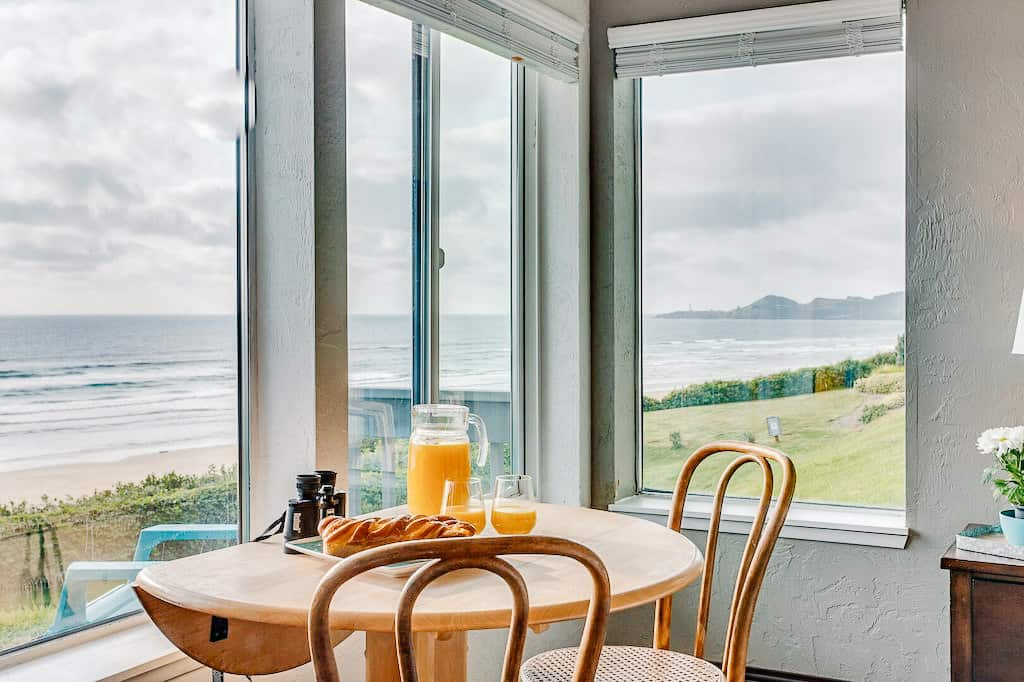 view of the ocean from a small table looking out the windows