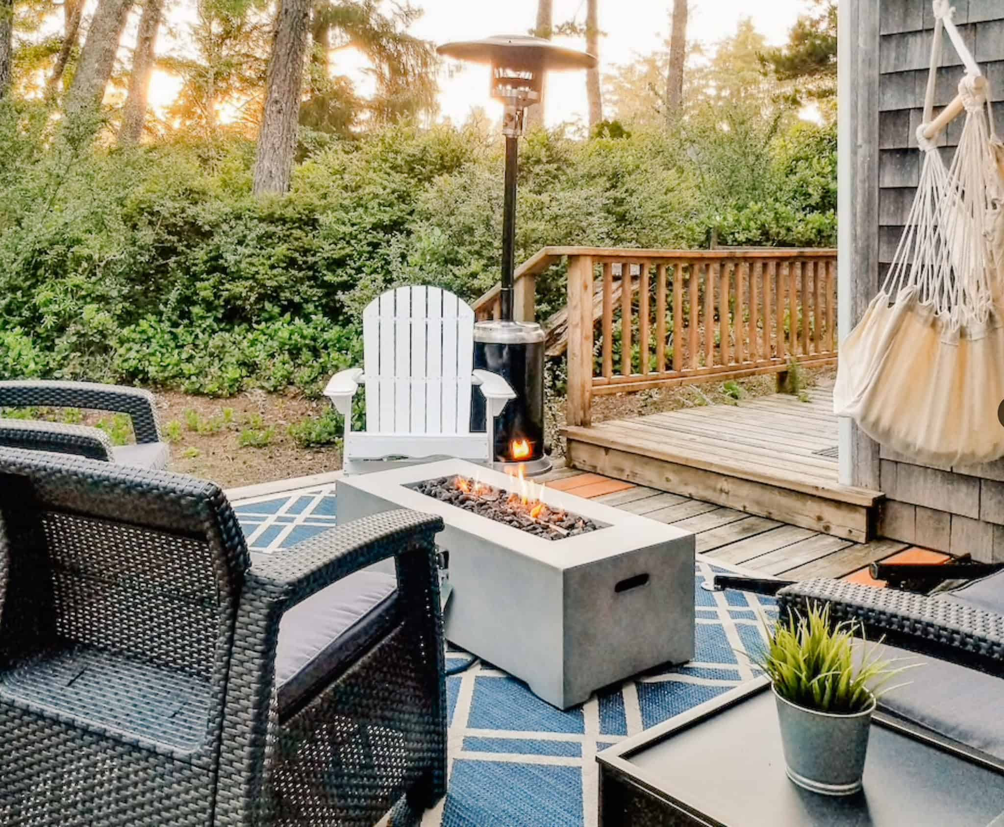 view of a patio with a gas fire place and hammock