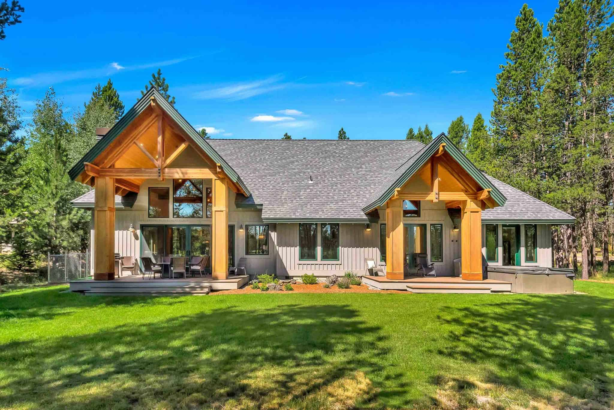 view of a luxury cabin with a grass front lawn