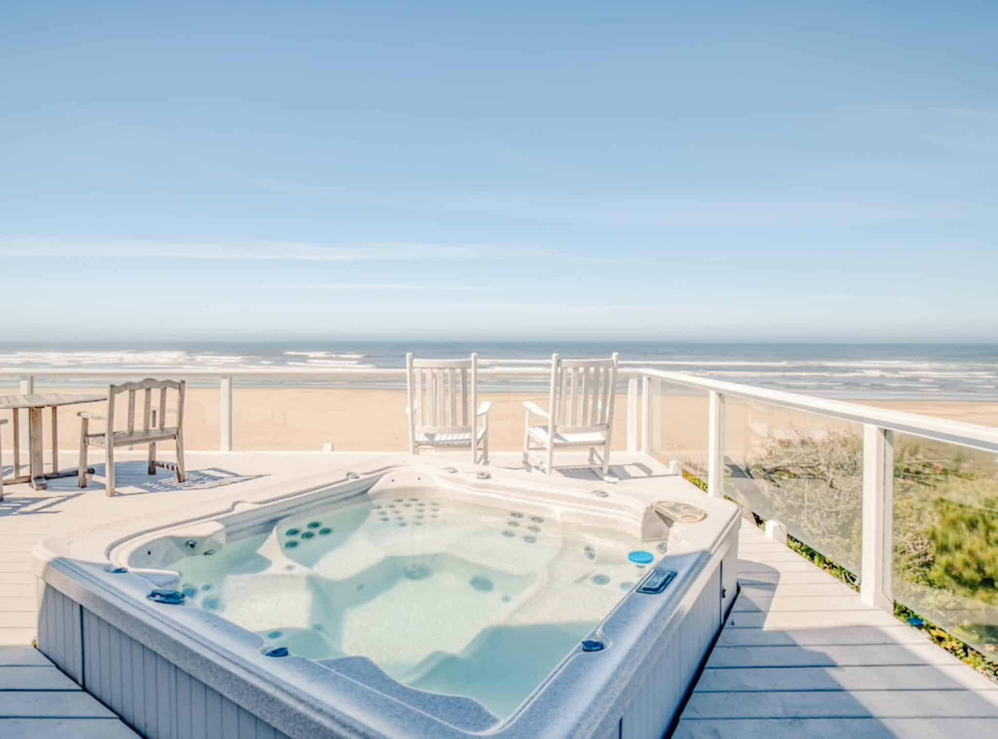 view of a hot tub on a deck near the ocean