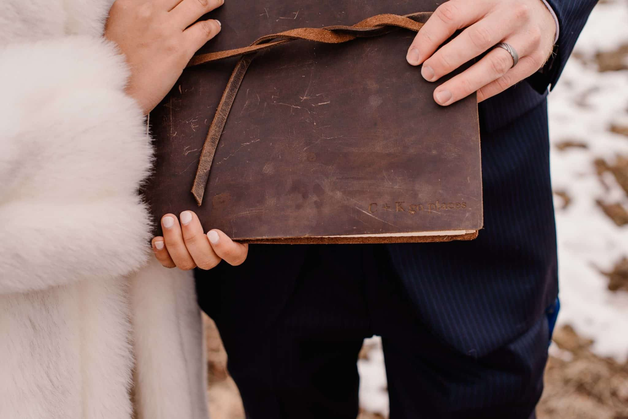 couple's leather bound adventure book that is helping them start a tradition and making their elopement day special