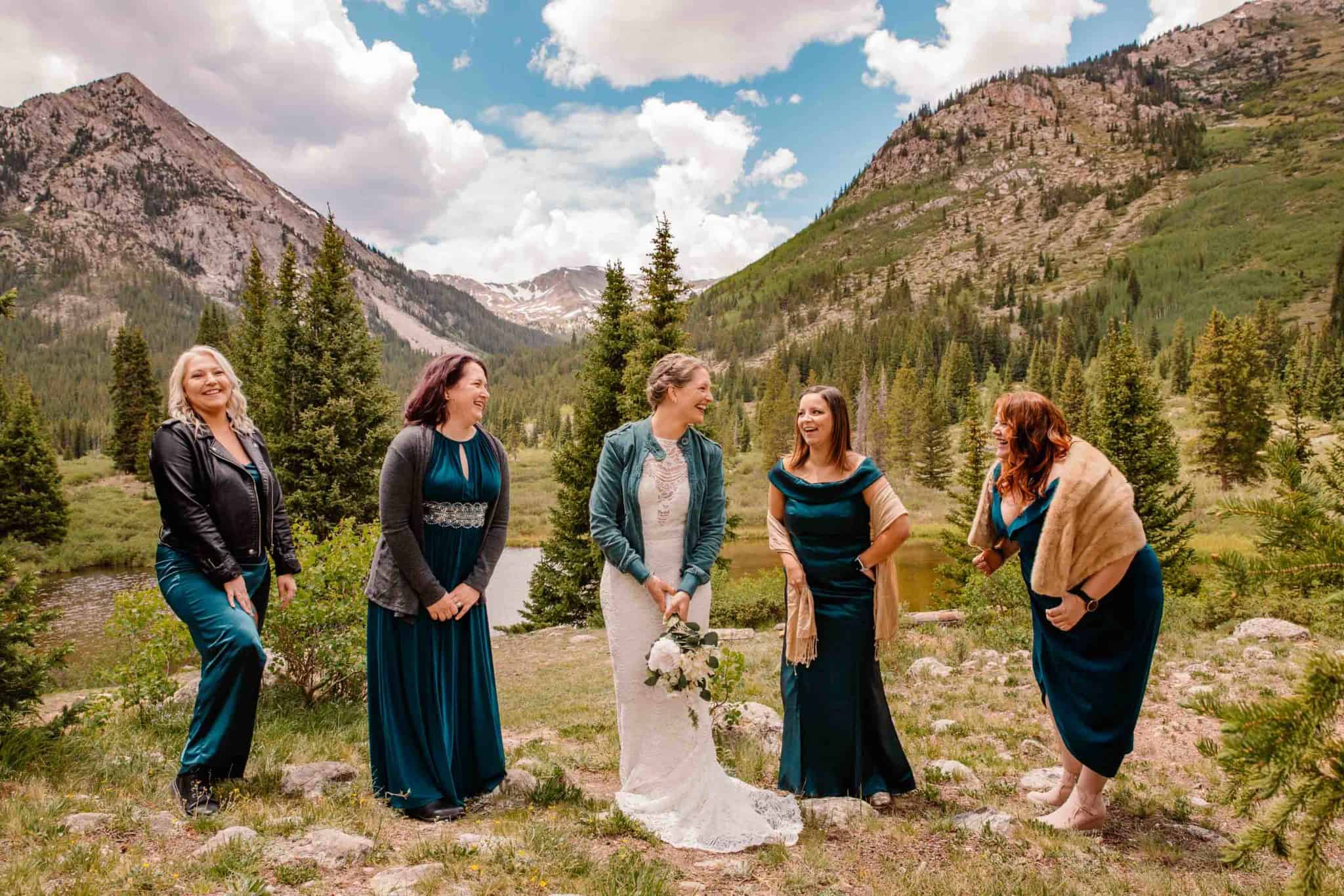 bride and her best friends at her elopement having them come to make her elopement feel special