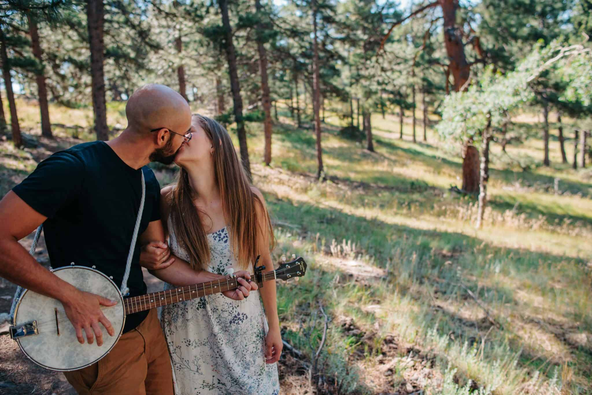 male playing guitar to make female feel special on elopement day