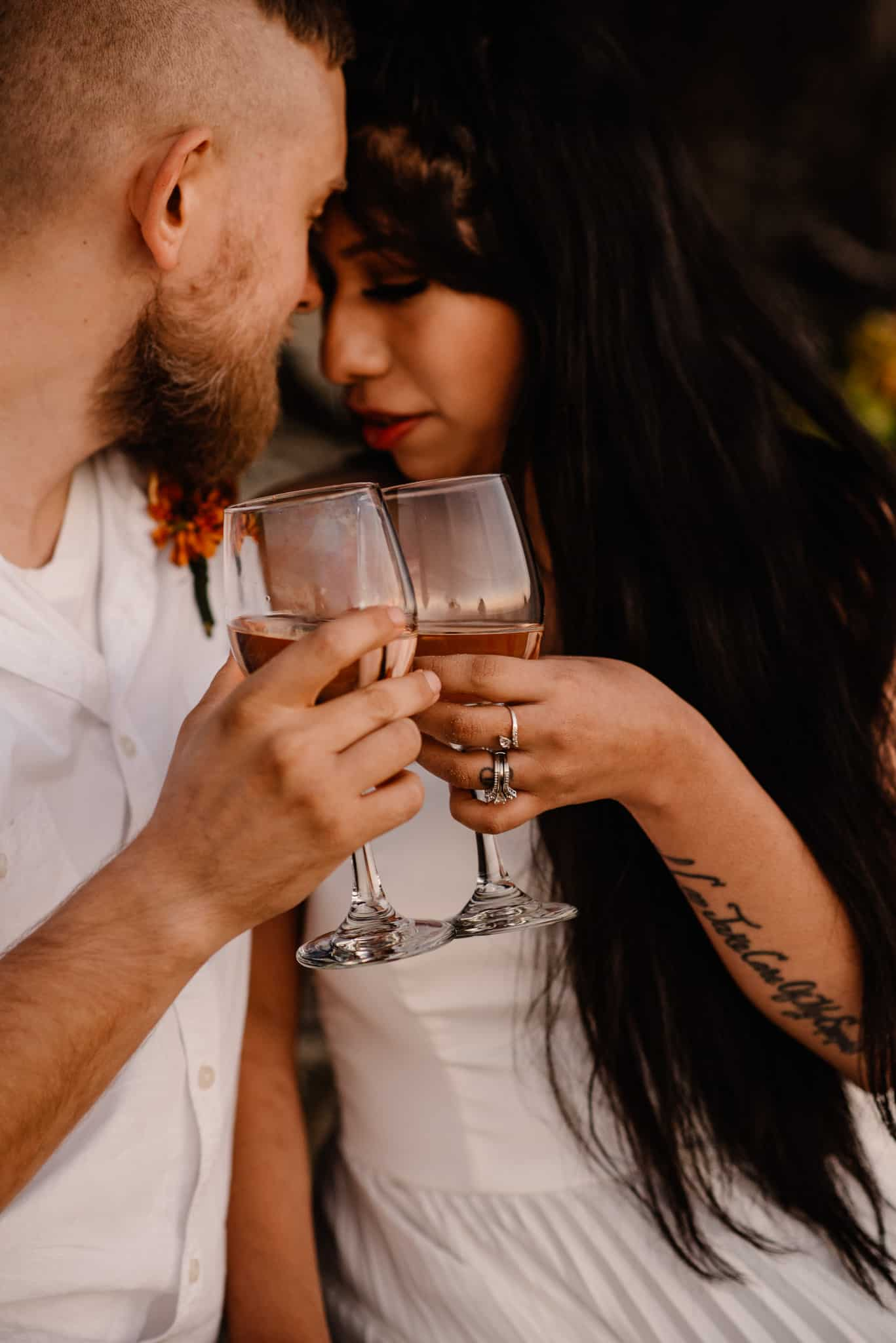 couple enjoying a nice glass of wine to make their elopement feel special