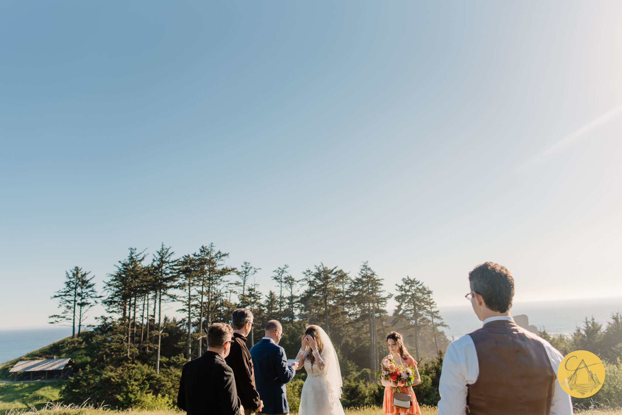 Ecola State Park wedding ceremony set up with the ocean an cliff in the background