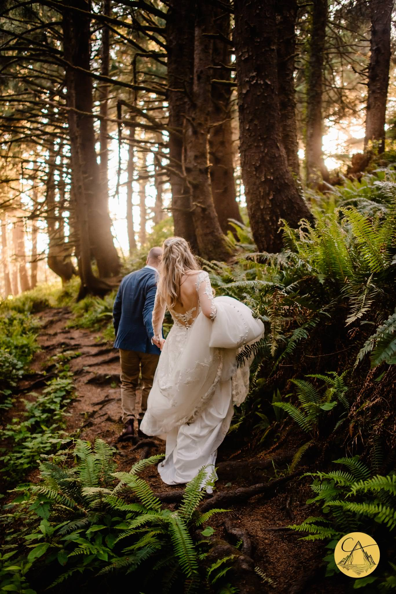 couple walking through the Ecola State Park forest after their wedding ceremony