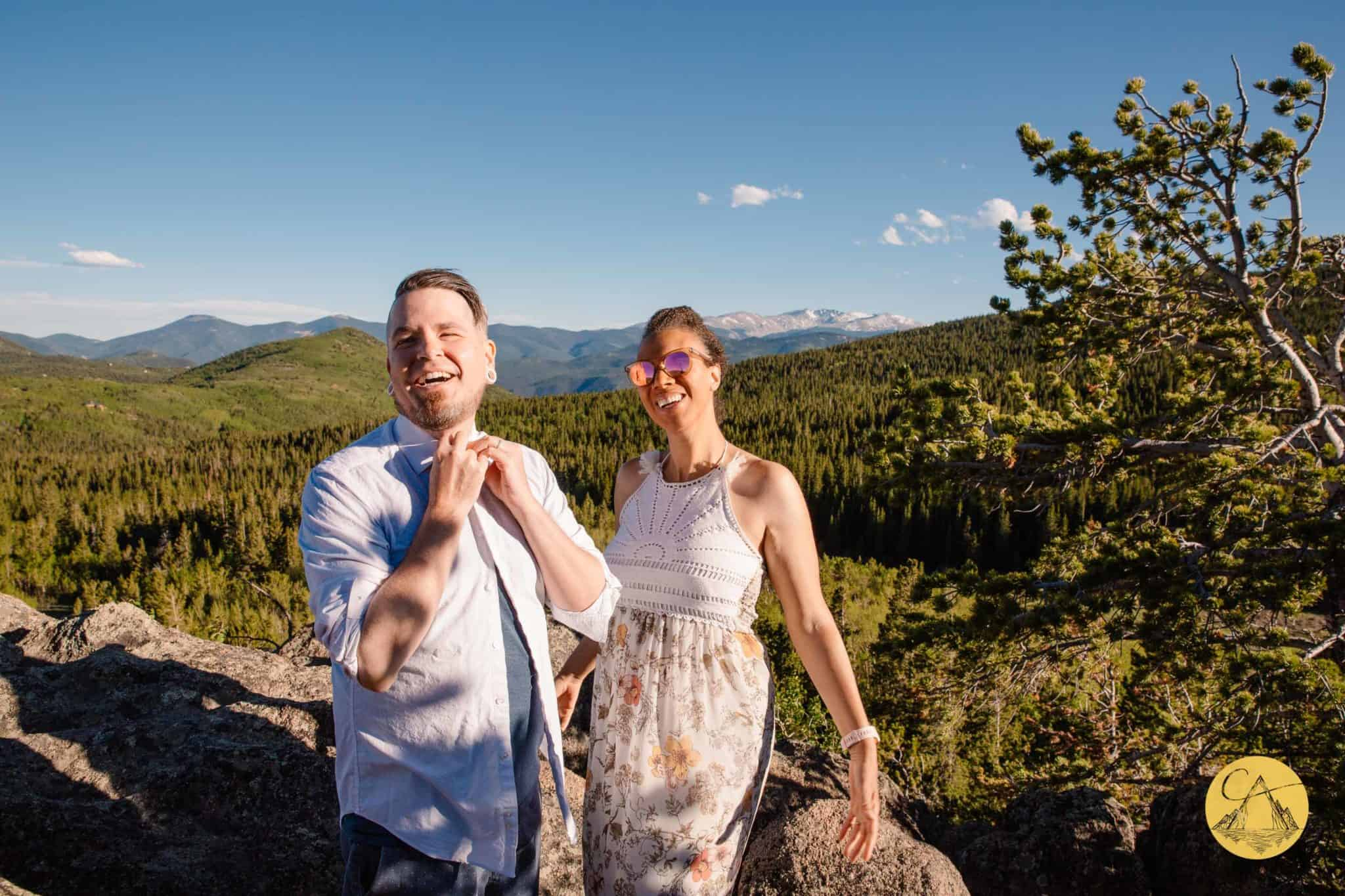 bride and groom getting ready on the top of a mountain for their 4x4 wedding