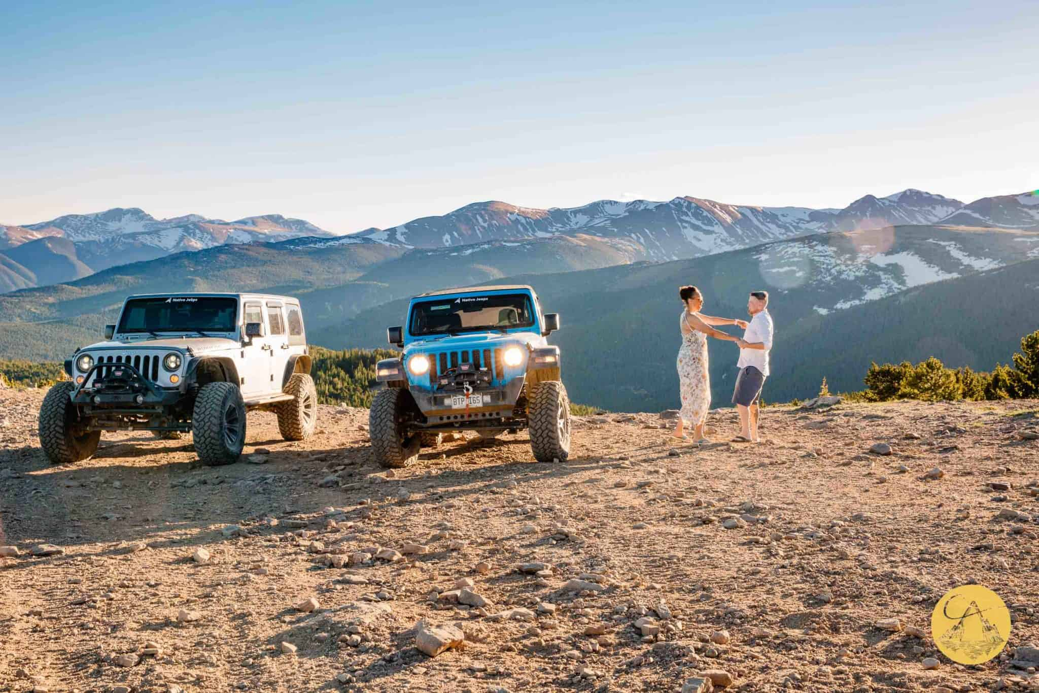 4x4 jeep wedding with couple dancing near jeep wranglers on the top of a mountain pass in Colorado