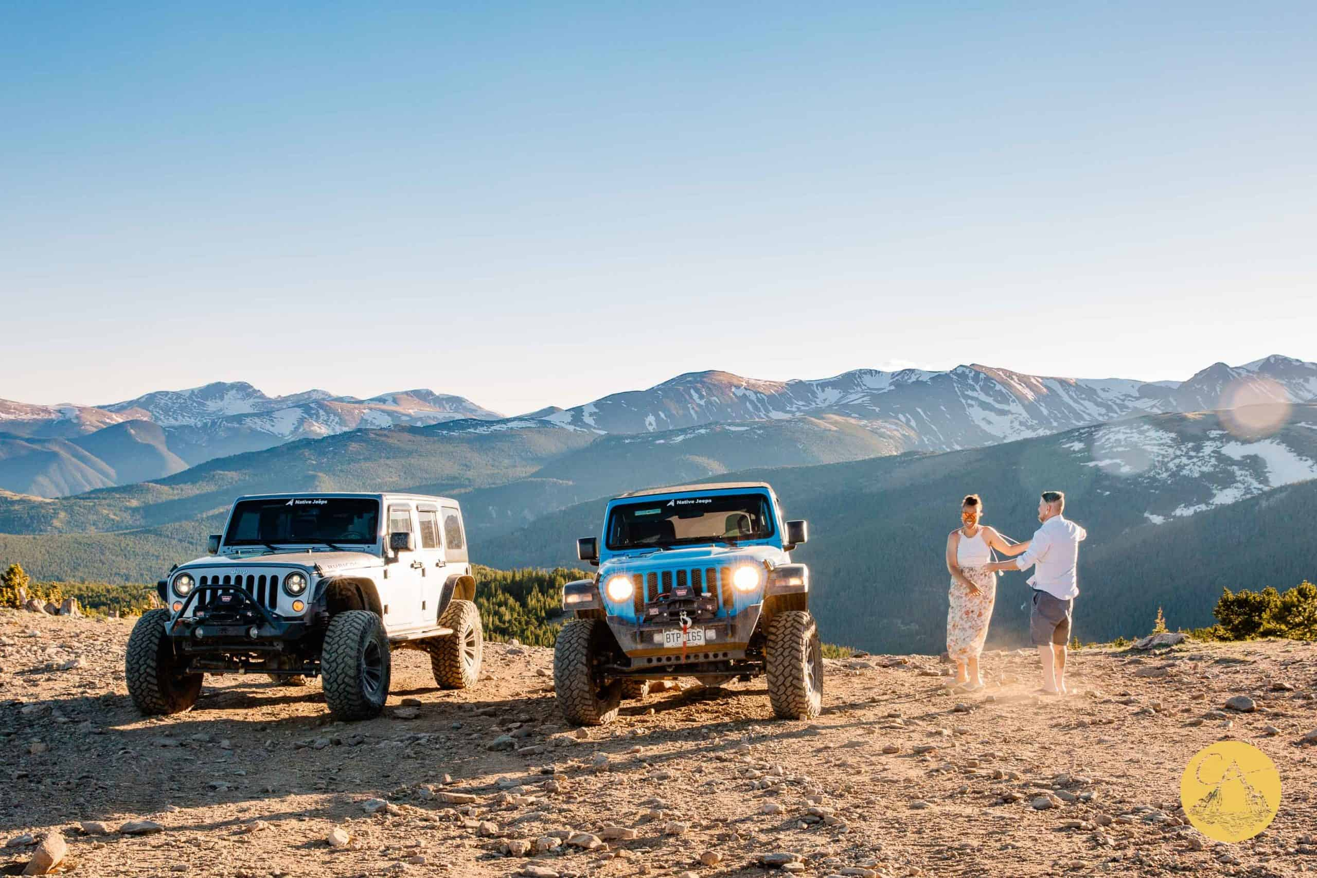 couple dancing on the top of a mountain at their 4x4 wedding in a jeep wrangler