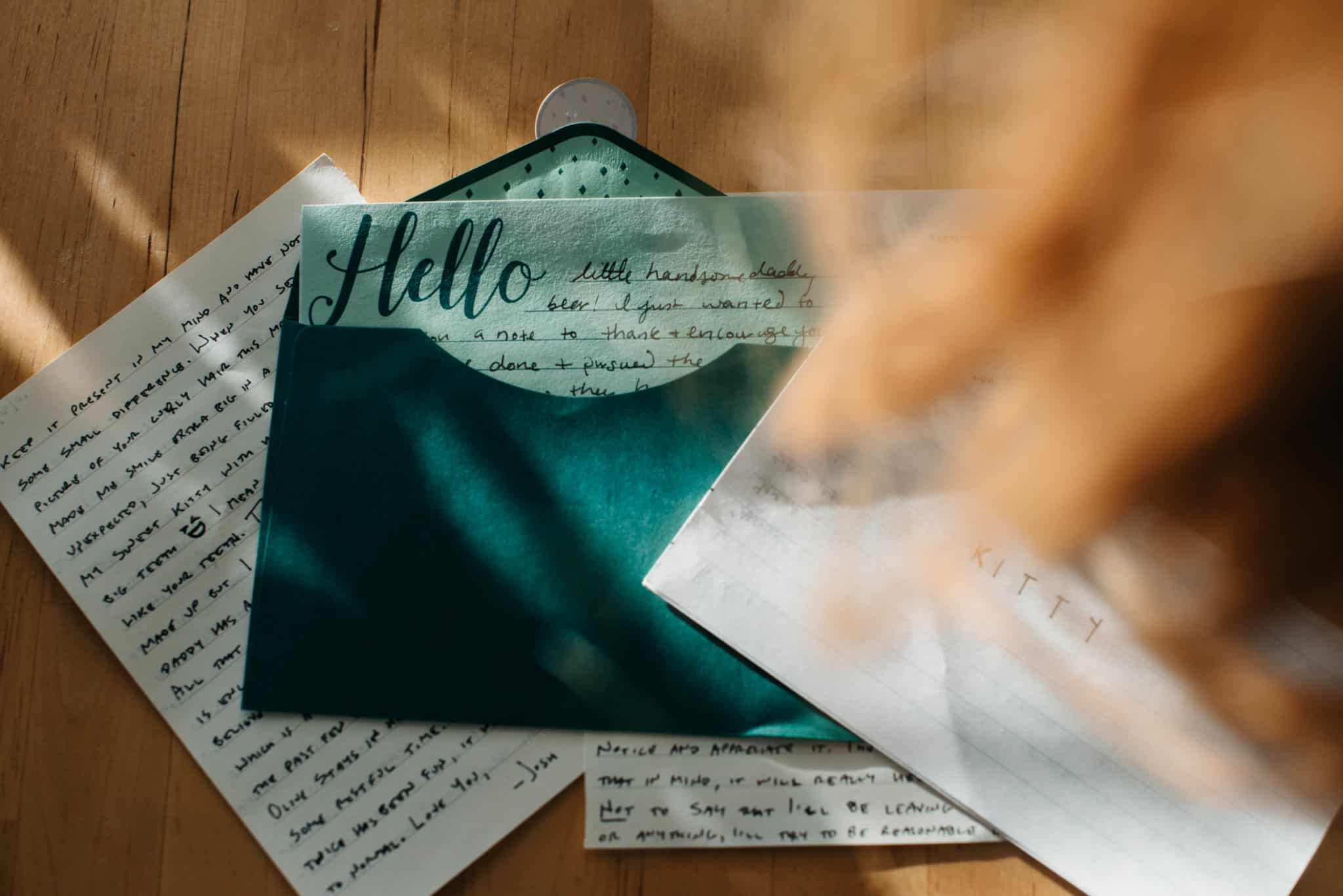 pile of love letters with hair falling down